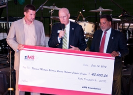Ryan presents a $40,000 check to the National Multiple Sclerosis Society National Chapter at this year's Night at the Park